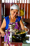 """Dona Mara making tortillas in her home in Chachagua, Costa Rica, Central America.  Dona invites people to her home to teach them how to make """"Tortillas con queso, (tortillas with cheese),"""" by hand, cooked on a wood-burning stove.  This is a traditional Costa Rican dish served with or without sour cream."""