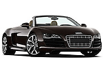 Low aggressive passenger side front three quarter view of a 2010 Audi R8 Spyder v10 2 Door Convertible.