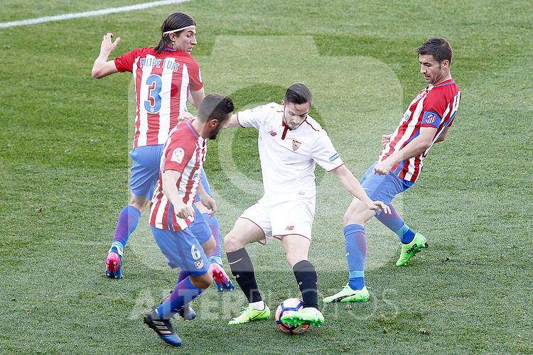 Atletico de Madrid's Filipe Luis (l), Koke Resurrecccion (2l) and Gabi Fernandez (r) and Sevilla FC's Pablo Sarabia during La Liga match. March 19,2017. (ALTERPHOTOS/Acero)