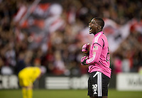Bill Hamid (28) of D.C. United celebrates a goal during the game at RFK Stadium in Washington, DC.  D.C. United defeated the Columbus Crew, 3-2.