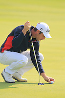 Romain Wattel (FRA) on the 8th green during Sunday's Final Round of the 2014 BMW Masters held at Lake Malaren, Shanghai, China. 2nd November 2014.<br /> Picture: Eoin Clarke www.golffile.ie