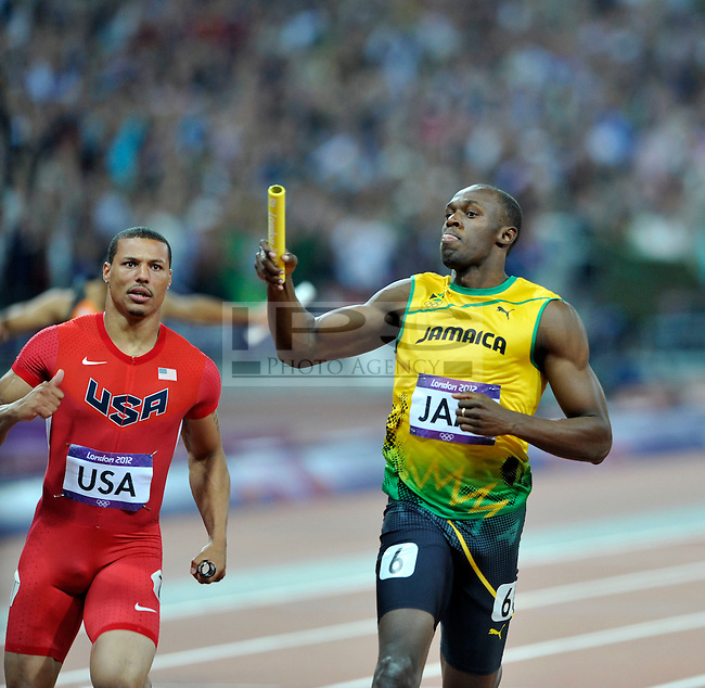 Usain Bolt (JAM) running the last leg of the 4x100m relay beats Ryan Baily to the line..Olympic Stadium.Olympic Park.Olympics 2012.London UK. .11/08/12,.photo: Sean Ryan / IPS Photo Agency.. mobile: 07971 400 939.Address: Thatched Cottage,Wretham,Thetford, Norfolk IP24 1RH .Office tel: 01953 499 403...