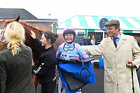 Jockey Charlotte Bennett is congratulated by Ralph Beckett after winning The Champagne Joseph Perrier Confined Handicap with Another Boy during Horse Racing at Salisbury Racecourse on 14th August 2019