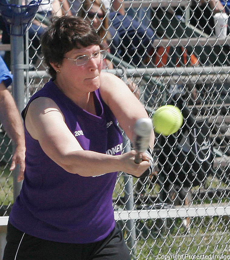 The DMR Construction softball player Cathy Wilkerson #11 hits the ball during The DMR Construction vs. Downtown Café game May 20,2012 (Photo by Gary Wilcox)