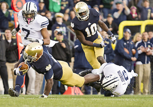 October 20, 2012:  Notre Dame running back Theo Riddick (6) runs the ball as BYU defensive back Jordan Johnson (6) defends during NCAA Football game action between the Notre Dame Fighting Irish and the BYU Cougars at Notre Dame Stadium in South Bend, Indiana.  Notre Dame defeated BYU 17-14.