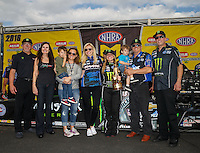 Mar 20, 2016; Gainesville, FL, USA; NHRA top fuel driver Brittany Force and funny car winner Robert Hight celebrates with family members including Ashely Force Hood , Courtney Force , Laurie Force , Mike Neff and John Force and Alan Johnson and crew chief Brian Husen after winning the Gatornationals at Auto Plus Raceway at Gainesville. Mandatory Credit: Mark J. Rebilas-USA TODAY Sports
