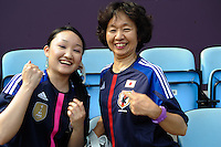 25.07.2012. Coventry, England. Womens football, Japan versus Canada. The first game of the tournament, held before the opening ceremonies, shows two Japanese supporters in upbeat mood