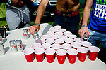 Joe Dilfore and Paul O'Connell of Santa Barbara, California pour beer into cups before a game of 21 cup rapid beer pong is played in the camping area outside of the Coachella Valley Music and Arts Festival in Indio, California April 10, 2015. (Photo by Kendrick Brinson)