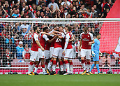 1st October 2017, Emirates Stadium, London, England; EPL Premier League Football, Arsenal versus Brighton; Nacho Monreal of Arsenal scores his sides first goal and celebrates with team mates, 1-0 Arsenal