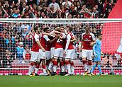 1st October 2017, Emirates Stadium, London, England; EPL Premier League Football, Arsenal versus Brighton; Nacho Monreal of Arsenal scores his sides first goal and celebrates with team mates, 1-0 Arsenal