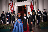 United States President Barack Obama and first lady Michelle Obama welcome President Francois Hollande of France on the North Portico of the White House before the State Dinner in Hollande's honor in Washington, District of Columbia, U.S., on Tuesday, Feb. 11, 2014.  After an arrival ceremony on the South Lawn, Obama and Hollande met in the Oval Office for a policy meeting then gave a joint press conference in the East Room of the White House. <br /> Credit: Pete Marovich / Pool via CNP