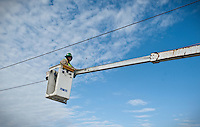 Dallas Area Rapid Transit apprentice Mitchell Wisdom (cq) pulls wires and hangs hangars at a new light rail transit stop for the new Green Line in Carrollton, Texas, USA, Thursday, Dec., 3, 2009. The City of Dallas hopes plans to open the new line in 2010...MATT NAGER/ BLOOMBERG NEWS