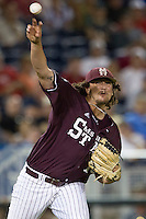 Mississippi State pitcher Jonathan Holder (14) makes a throw to first base for the final out against the Indiana Hoosiers during Game 6 of the 2013 Men's College World Series on June 17, 2013 at TD Ameritrade Park in Omaha, Nebraska. The Bulldogs defeated Hoosiers 5-4. (Andrew Woolley/Four Seam Images)