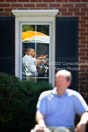 United States President Barack Obama holds a backyard discussion at the home of John and Nicole Armstrong to discuss with their neighbors Recovery Act investments in Fairfax, Virginia on 13 September, 2010. .Credit: Jim Lo Scalzo - Pool via CNP