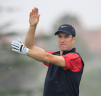 Ross Fisher (ENG) checks wind direction on the 6th tee during Saturay's Round 3 of the 2014 BMW Masters held at Lake Malaren, Shanghai, China. 1st November 2014.<br /> Picture: Eoin Clarke www.golffile.ie