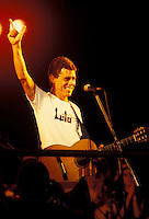 Brazilian artist Chico Buarque de Hollanda supports Lula for president of Brazil during music show. activism, politic, musician, singer, demonstration.