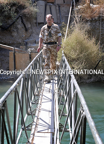 "PRINCE EDWARD.walking across the footbridge in the confines of Sangin Main operating Base, the footbridge crosses the Helmand River which divides the camp in two..The Regimental Colonel for the Rifles Regiment, HRH The Earl of Wessex paid a visit to the soldiers of 2 Rifles Battle group in the front line in Helmand province. Prince Edward spent time talking to the soldiers , who have spent the last 5 months bringing security to the town of Sangin and the upper Sangin valley_9/09/2009.Photo Credit: ©Wood_Newspix International..**ALL FEES PAYABLE TO: ""NEWSPIX INTERNATIONAL""**..PHOTO CREDIT MANDATORY!!: NEWSPIX INTERNATIONAL..IMMEDIATE CONFIRMATION OF USAGE REQUIRED:.Newspix International, 31 Chinnery Hill, Bishop's Stortford, ENGLAND CM23 3PS.Tel:+441279 324672  ; Fax: +441279656877.Mobile:  0777568 1153.e-mail: info@newspixinternational.co.uk"