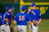 Tanner Poppe (55) of the Kansas Jayhawks talks with pitching coach Ryan Graves (16) on the mound during a game against the Missouri State Bears at Hammons Field on March 27, 2012 in Springfield, Missouri. (David Welker/Four Seam Images)