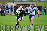 John Egan (Ardfert) in action with Denis Daly (St Mary's) in the County Intermediate Football Championship round 1 at Ardfert on Saturday evening.