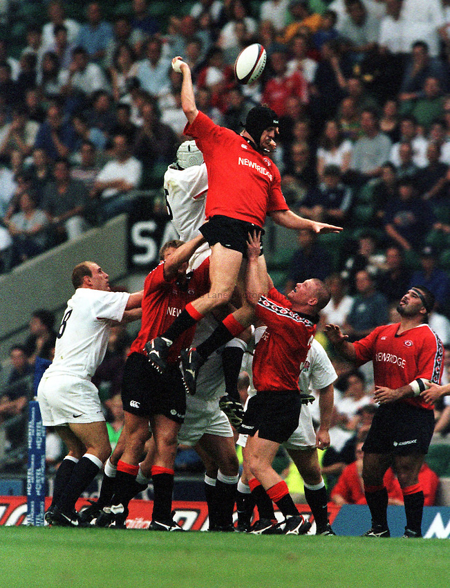 Photo. Richard Lane.England v Canada. 28/8/99..John Tait out jumps Danny Grewcock at a line out.