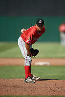 Batavia Muckdogs relief pitcher Karl Craigie (12) looks in for the sign during a game against the Auburn Doubledays on June 17, 2018 at Falcon Park in Auburn, New York.  Auburn defeated Batavia 10-6.  (Mike Janes/Four Seam Images)