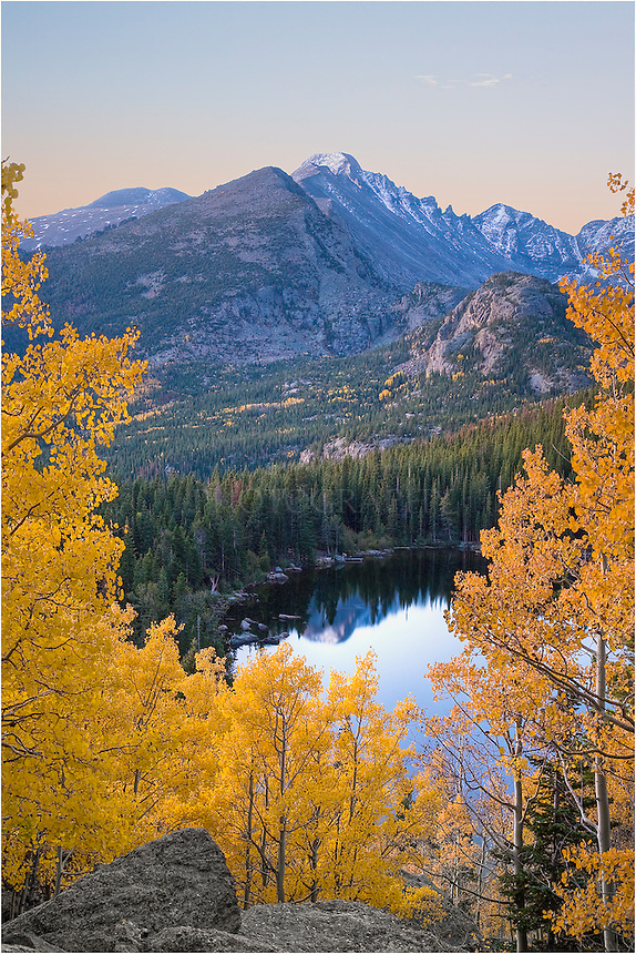 In the Autumn in Colorado National Park, the view of Longs Peak through the Aspen trees is a wonderful sight. This image was taken behind Bear Lake. You have to hike up a bouder field to reach this spot, and I did it in the dark so I could capture this image with perfect light.
