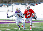 University at Albany Men's Lacrosse defeats Cornell 11-9 on Mar 4 at Casey Stadium.  Connor Fields (#5) is defended by Jake Pulver (#34).