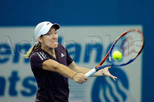 04.01.2010 Justine Henin-Hardenne (bel) defeats Petrova (Rus ) (7-5 and.7-5)  in the first round of the ladies tournament. Photo: Photoshot/Actionplus - Editorial Use