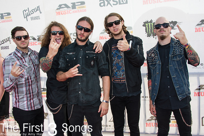 Levi Benton, Ryan Neff, Jerod Boyd, Justin Aufdemkampe, and B.J. Stead of Miss May I attend the 2014 AP Music Awards at the Rock And Roll Hall Of Fame and Museum at North Coast Harbor in Cleveland, Ohio.