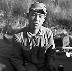 A South Korean soldier, who fought along side the U.S. Army, Second Infantry Division soldiers, poses for a portrait one afternoon during the Korean War. These are photos of the 2nd Infantry Division in the Korean War in 1950 or 1951.