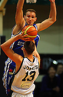 Saints centre Nick Horvath leaps to block Phill Jones' pass during the NBL Semifinal basketball match between the Wellington Saints and Nelson Giants at TSB Bank Arena, Wellington, New Zealand on Thursday, 12 June 2008. Photo: Dave Lintott / lintottphoto.co.nz