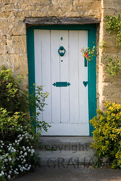 Traditional cottage front door and doorway, Stanton village, The Cotswolds, Gloucestershire, United Kingdom