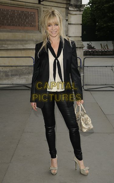 JO WOOD.Lulu Guinness' 20th Anniversary Party at the Victoria and Albert Museum, London, England..June 8th, 2009.V&A V & A full length black white cardigan top leggings leather grey gray shoes gold bag purse scarf jacket.CAP/CAN.©Can Nguyen/Capital Pictures.