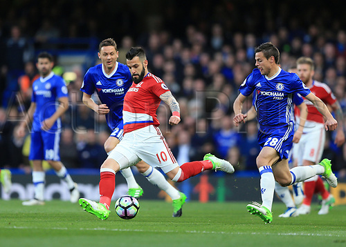 May 8th 2017, Stamford Bridge, Chelsea, London England; EPL Premier League football, Chelsea FC versus Middlesbrough; Alvaro Negredo of Middlesbrough kicks the ball out with Cesar Azpilicueta of Chelsea chasing