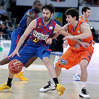 FC Barcelona Regal's Juan Carlos Navarro (l) and Valencia Basket Club's Rodrigo San Miguel during Spanish Basketball King's Cup Final match.February 07,2013. (ALTERPHOTOS/Acero)