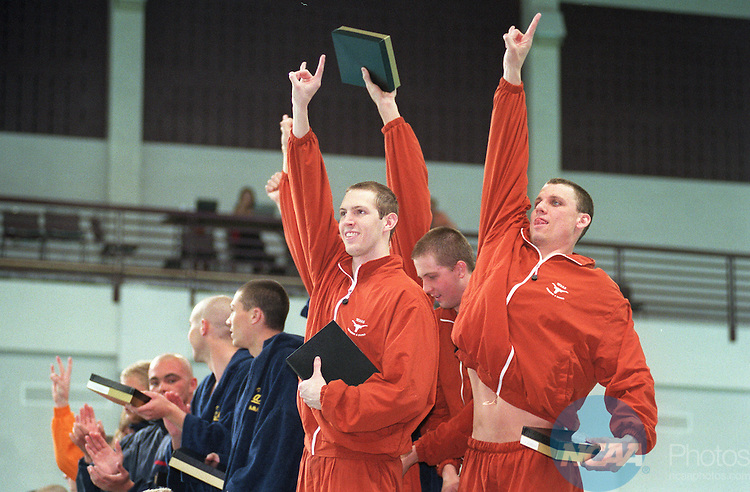 24 MAR 2001: Members of the University of Texas Longhorn swimming program celebrate their overall win during the NCAA Men's Division 1 swimming and diving championships held at the student recreation center natatorium on the campus of Texas A&M University in College Station, TX.   © Mark Matson / NCAA Photos