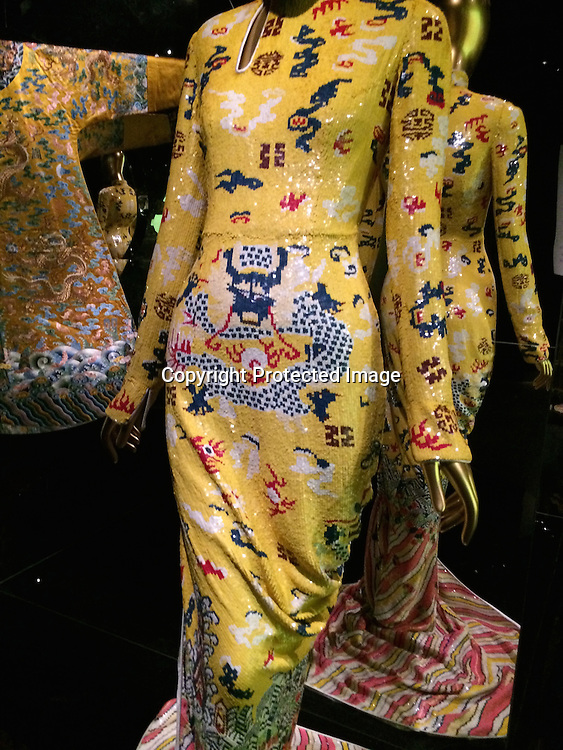 Yves Saint Laurent (French, founded 1961)Tom Ford (American, born 1961)Evening dress, autumn/winter 2004–Yellow silk satin embroidered with polychrome plastic sequins Courtesy of Yves Saint Laurent, Paris