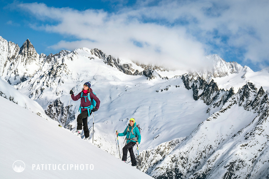 Two women ski touring above Guttanen, near the Grimsel Pass, Switzerland