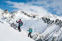 Two women ski touring above Guttanen, near the Grimsel Pass, Switzerland