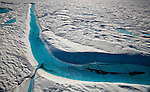 Blue Melt River, Petermann Glacier, in remote northwestern Greenland, on Nares Strait.  Photographed during a 2009 Greenpeace expedition to investigate the effects of climate change in the Arctic. In 2010 and 2012 Petermann calved ice islands totalling 400 square kilometres.