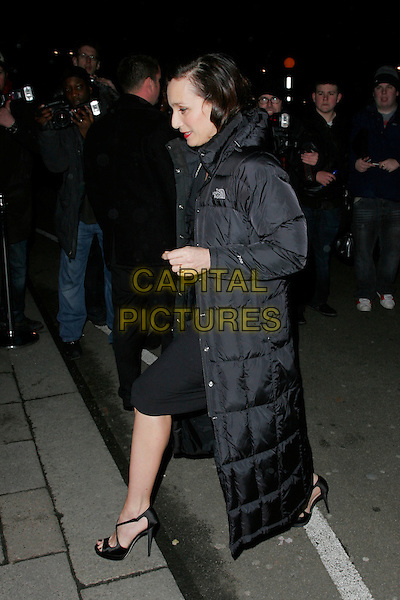 KRISTIN SCOTT THOMAS .The Finch & Partners' Chanel Pre-BAFTA Party held at Annabel's, London, England..February 7th, 2009.full length black dress puffa jacket long heels profile.CAP/AH.©Adam Houghton/Capital Pictures.