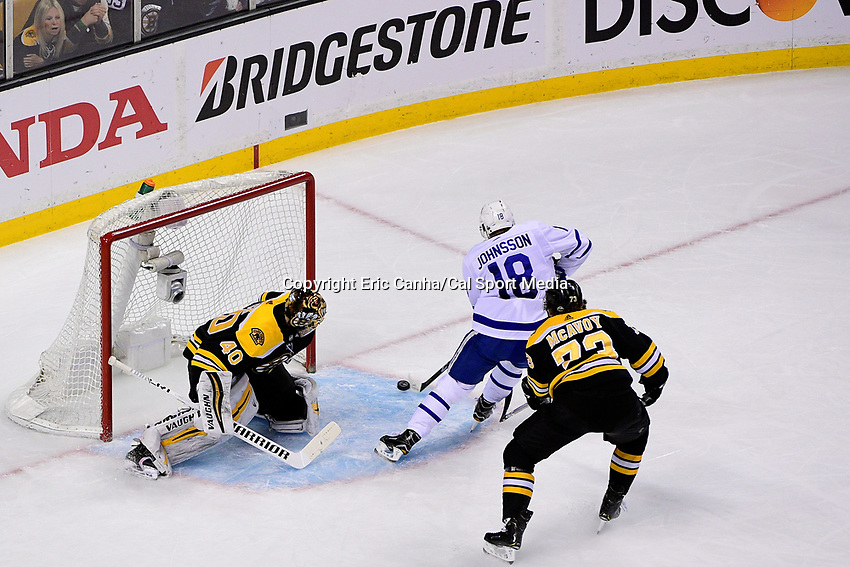 April 21, 2018: Toronto Maple Leafs left wing Andreas Johnsson (18) scores against Boston Bruins goaltender Tuukka Rask (40) during game five of the first round of the National Hockey League's Eastern Conference Stanley Cup playoffs between the Toronto Maple Leafs and the Boston Bruins held at TD Garden, in Boston, Mass. Toronto defeats Boston 4-3, Boston leads Toronto 3 games to 2 in the best of 7 series.