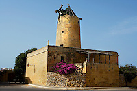 Low angle view of Ta' Kola Windmill, 1725, Xaghra, Gozo, Malta, pictured on June 2, 2008, in the afternoon. The Republic of Malta consists of seven islands in the Mediterranean Sea of which Malta, Gozo and Comino have been inhabited since c.5,200 BC. It has been ruled by Phoenicians (Malat is Punic for safe haven), Greeks, Romans, Fatimids, Sicilians, Knights of St John, French and the British, from whom it became independent in 1964. Ta' Kola windmill was built by the Fondazione Manoel  during the reign of Grand Master Manoel de Vilhena and is now a folklore museum. In the early 20th century the miller was Nikola, or Kola, Grech for whom it is now named. It is one of the few remaining examples of 18th century Maltese industrial heritage. Picture by Manuel Cohen.