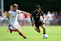 Lincoln City's Josh Ginnelly vies for possession with Lincoln United's Sean Wright<br /> <br /> Photographer Chris Vaughan/CameraSport<br /> <br /> Football - Pre-Season Friendly - Lincoln United v Lincoln City - Saturday 8th July 2017 - Sun Hat Villas Stadium - Lincoln<br /> <br /> World Copyright &copy; 2017 CameraSport. All rights reserved. 43 Linden Ave. Countesthorpe. Leicester. England. LE8 5PG - Tel: +44 (0) 116 277 4147 - admin@camerasport.com - www.camerasport.com