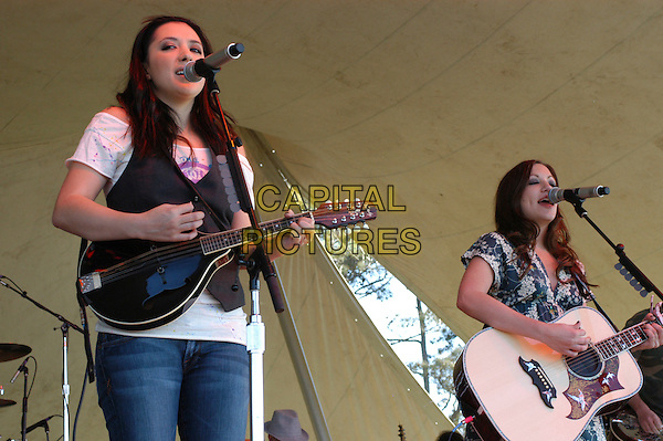 "THE WRECKERS - MICHELLE BRANCH & JESSICA HARP.Bring their ""Stand Still, Look Pretty"" tour to the VB Bike Classic, Virginia Beach, Virginia, USA..April 21st, 2007.half length stage concert live gig performance music guitar  singing .CAP/ADM/MK.©Mike Kline/AdMedia/Capital Pictures"