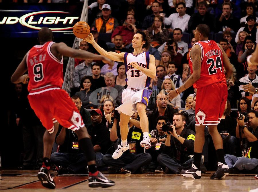 Jan. 22, 2010; Phoenix, AZ, USA; Phoenix Suns guard (13) Steve Nash passes the ball against Chicago Bulls at the US Airways Center. Mandatory Credit: Mark J. Rebilas-