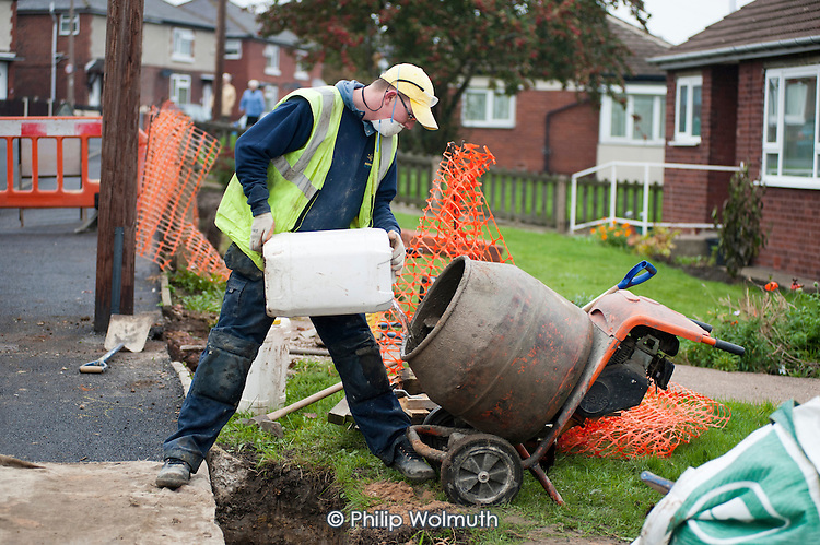 Construction team of ex-trainees at Barnsley Community Build, a social enterprise, working on a council contract at a housing estate in Royston, South Yorkshire.
