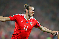 Gareth Bale of Wales celebrates scoring his side's third goal during the FIFA World Cup Qualifier match between Wales and Moldova at Cardiff City Stadium, Cardiff, Wales on 5 September 2016. Photo by Mark  Hawkins.