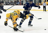 George Mason's Tyler D'Agostino (28) is sent flying after a check by George Washington defenseman John Wright (3). George Mason defeated George Washington 5-2 on 9-22-18.<br />