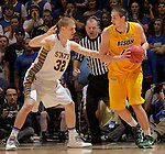 SIOUX FALLS, SD - MARCH 12:  Marshall Bjorklund #42 of North Dakota State looks past South Dakota State defender Marcus Heemstra #32 during their championship game at the 2013 Summit League Tournament at the Sioux Falls Arena. (Photo by Dick Carlson/Inertia)